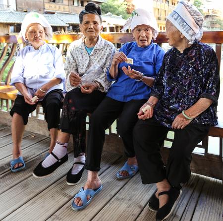 miao: the old women chatting in xijiang miao village,guizhou,china