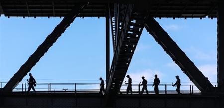 visitors: visitors walking through harbour bridge in sydney,australia Stock Photo