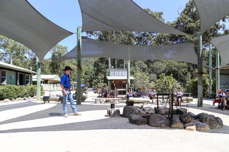 gold coast australia: billy tea performance in paradise country aussie farm,gold coast,australia Editorial