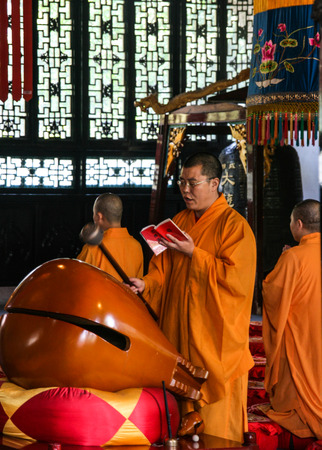 scriptures: monks recite scriptures in daci temple,chengdu,china
