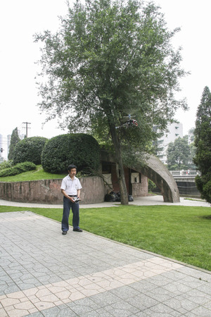 selfmade: man playing selfmade glider in chengdu,china Editorial