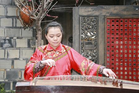 pipa: young woman playing the pipa in  kuanzhai alley , chengdu,china