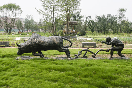 plowing: the sculpture of cow plowing