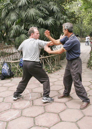 foreigners: foreigners practicing chinese martial arts in a park,chengdu,china