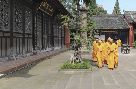 cassock: monks in wensu temple,chengdu,china Editorial