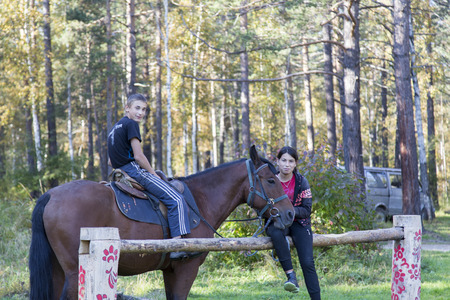 the federation: brother and sister with their horse in russian federation