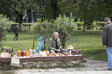 wares: hawker selling wares in open-air market,suzdal,russian federation
