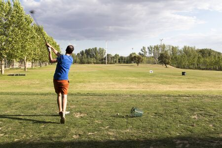 a man playing golf in golf course,salamanca,spain