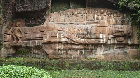 the sculpture of sleeping buddhist in a temple, china
