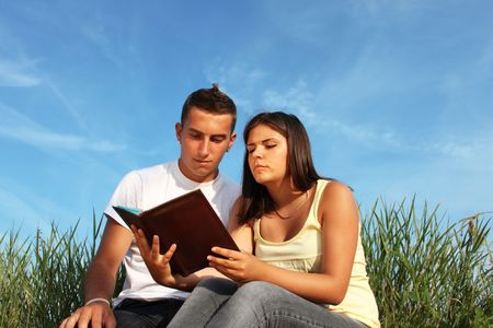 beautiful, beauty, book,  couple,education, female, friends, girl, grass, green, holding, learning,  love, male, man, nature, outdoors,reading,  sitting,  student, studying,teenager, teenagers, two, white, woman, young Stock Photo - 5798276