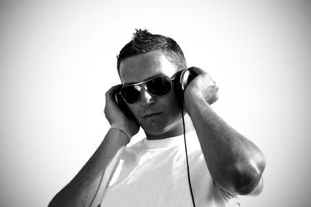 cool dj with headphones - grayscale photo