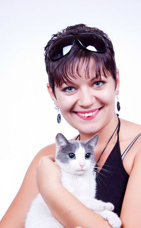 pillowy: cute woman with domestic cat in her hands Stock Photo