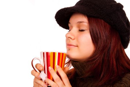 young cute girl enjoying in cup of tea photo