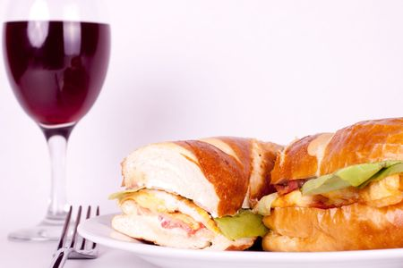 close up of hot sandwich and a glass of wine photo