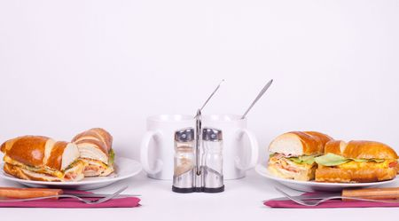 delicius sandwich with set for dining and cups of tea photo