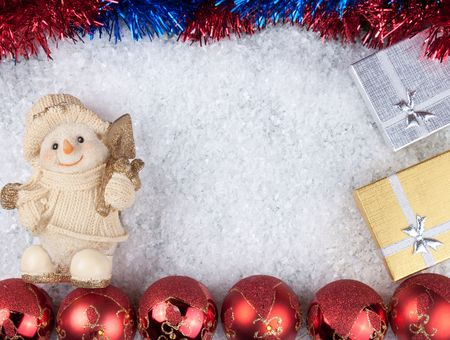 Christmas background - snowman, christmas balls and boxes on snow photo