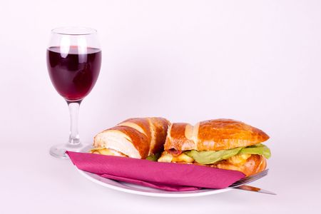 delicius sandwich with set for dining, and glass of wine photo