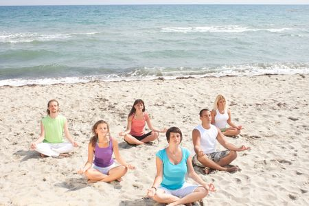 meditation group on the beach, from top view photo