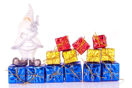 santa claus figure on presents in line on white background photo