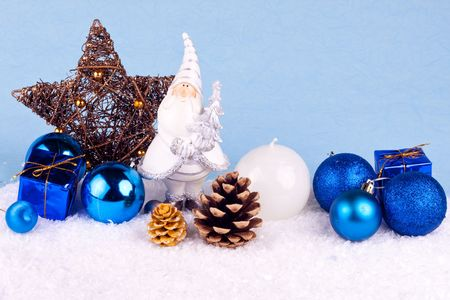 christmas decoration - santa claus figure on blue background photo