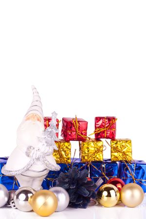 santa claus figure with presents and xmas balls on white background photo