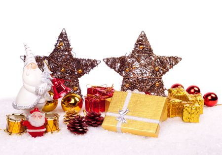 cute ceramic santa with xmas ornaments on snow photo