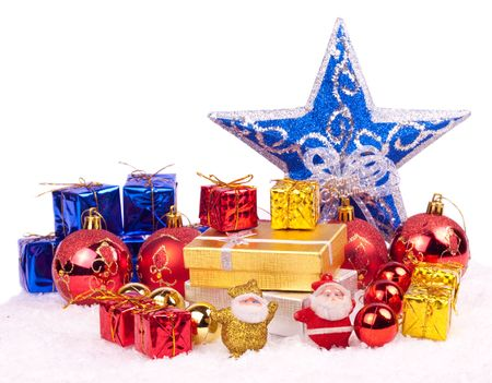 red, gold and blue mix from xmas ornaments in snow photo
