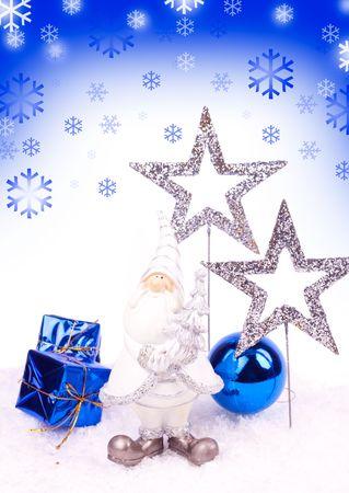 santa figure , blue xmas balls and silver stars on snow photo