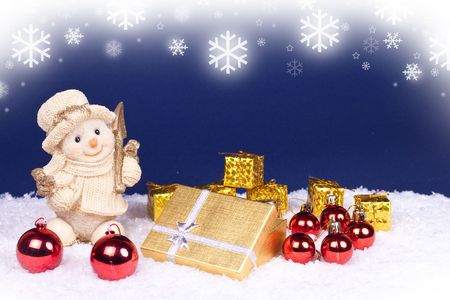 golden snowman figure and red , gold xmas balls photo