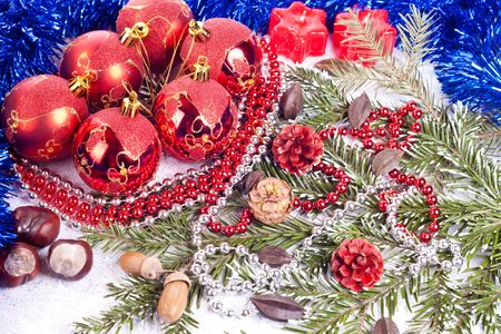 xmas balls, pearls, fir tree, candles and blue ribbons photo