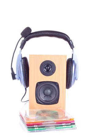 headphone with microphone on loudspeaker box and a group of disks photo