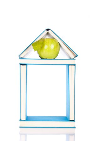 house made from blue books, and green apple Stock Photo - 6064313