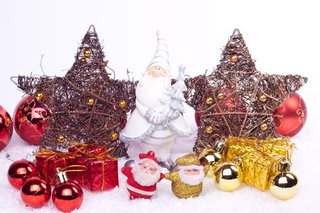 xmas background - santa ceramic toy between stars, xmas balls and gifts photo