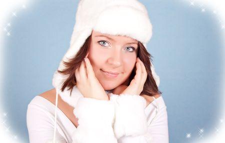 lovely girl in white, like an angel posing on blue background photo