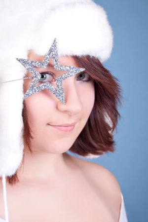 cloath: cute xmas queen looking through a silver star Stock Photo