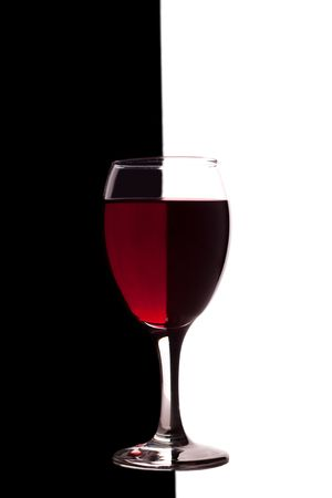 glass of red wine on black and white background photo