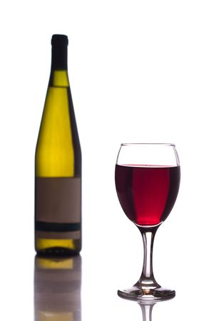 glass of  red wine and bottle isolated on white photo