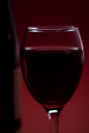 close up of glass of red wine  photo
