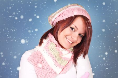 beautiful girl smiling on blue backgroung with snowflakes photo