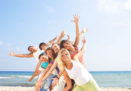 group travel: happy group of young people having fun