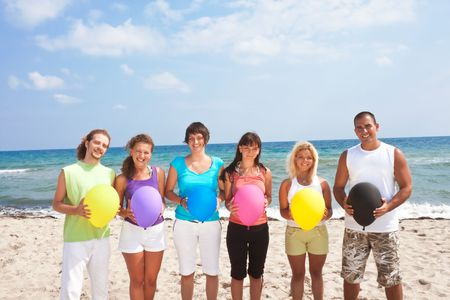 happy young people holding balloons on the beach Stock Photo - 6279821