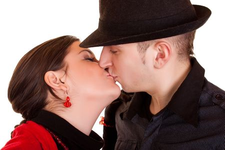 Girl in red kissing a boy in hat photo