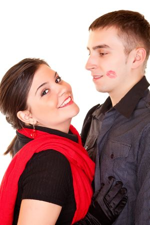 smiling girl and her boyfriend with lipstick on his face photo
