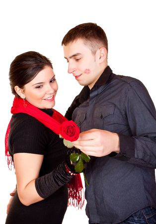 young man giving a rose to her girlfriend photo