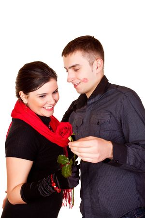 young man giving a red rose to her girlfriend photo