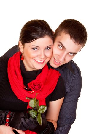 beautiful smiling couple holding a red rose Stock Photo - 6369588