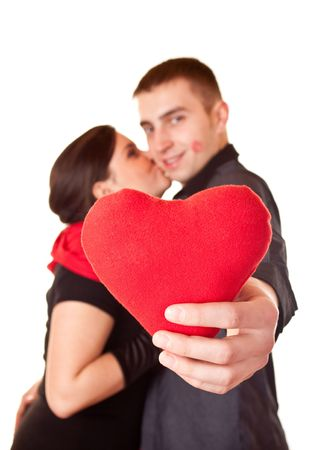 young smiling couple holding a heart shape Stock Photo - 6369587