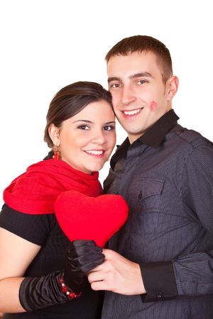 young smiling couple holding a red heart Stock Photo - 6369586