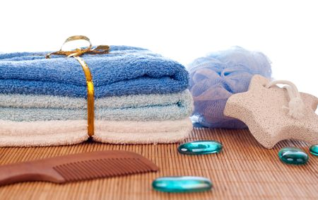 towels, sponge, stone for foot, comb and decorative stones photo