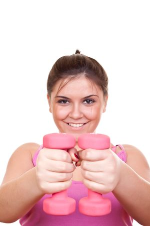 beautiful smiling young girl in pink holding weight for exercise photo